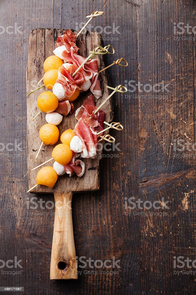 Mozzarella, prosciutto, melon canapes stock photo