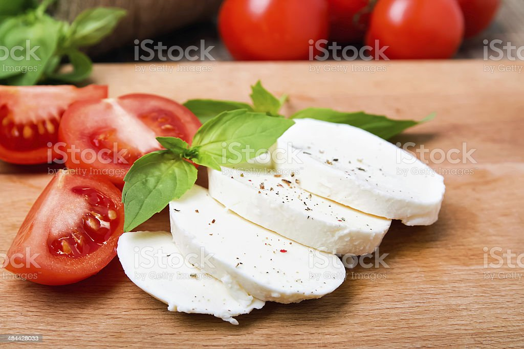 Mozzarella, tomatoes and basil stock photo