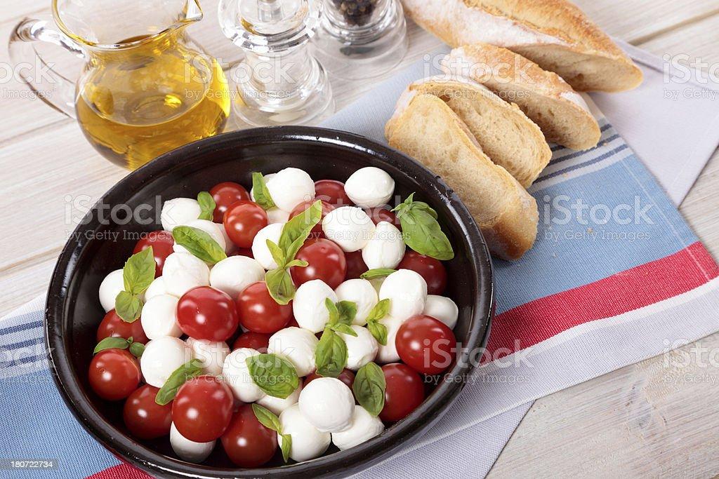 Mozzarella, tomatoes and basil salad royalty-free stock photo