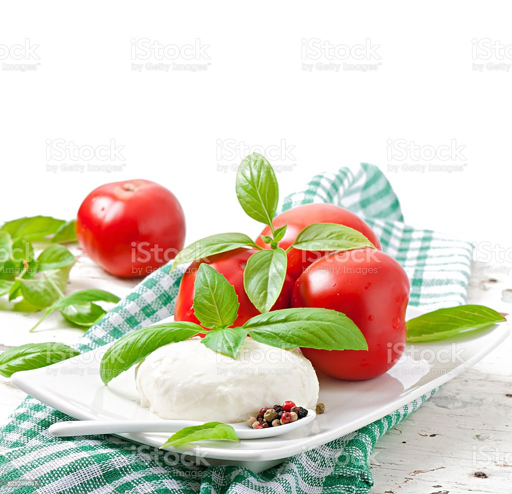 Mozzarella, tomatoes and fresh basil leaves stock photo