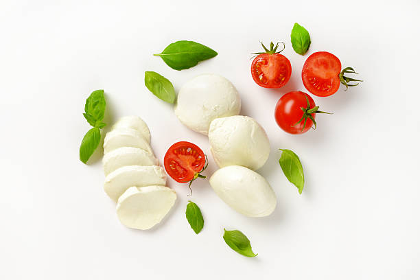 mozzarella, tomatoes and fresh basil - mozzarella foto e immagini stock
