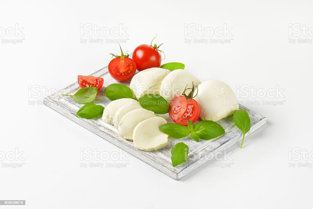 mozzarella, tomatoes and fresh basil stock photo