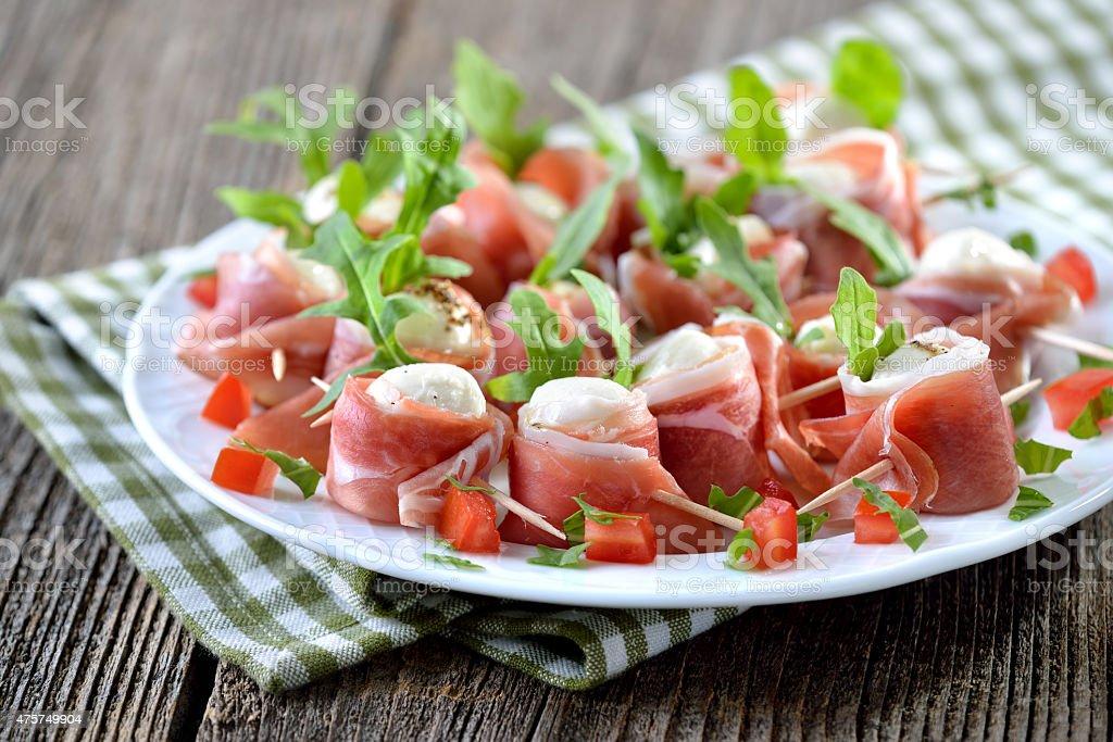 Mozzarella with bacon stock photo