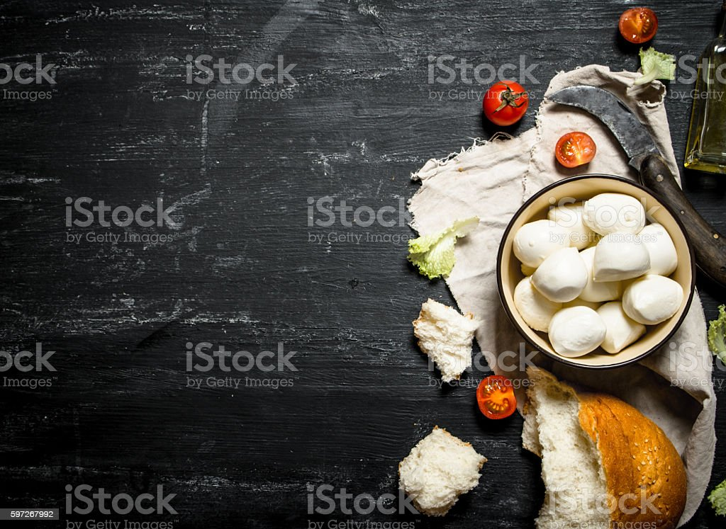 Mozzarella with fresh bread, tomatoes and greens. royalty-free stock photo