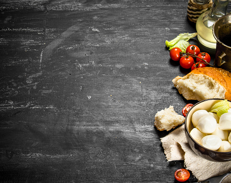 Mozzarella With Fresh Bread Tomatoes And Greens Stock Photo & More Pictures of Appetizer