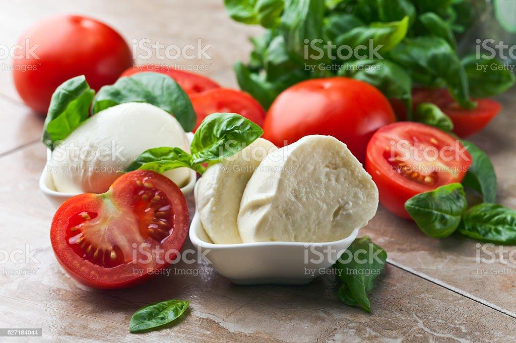 mozzarella with tomato and basil stock photo