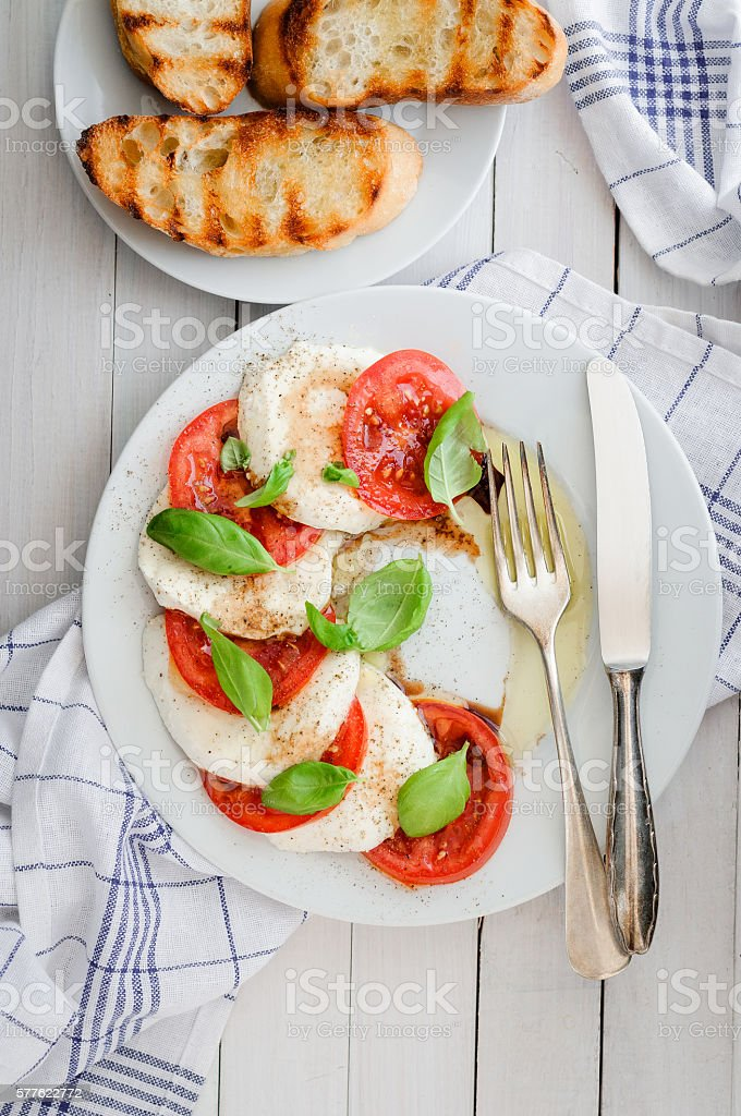 Mozzarella with tomatoes on white plate stock photo