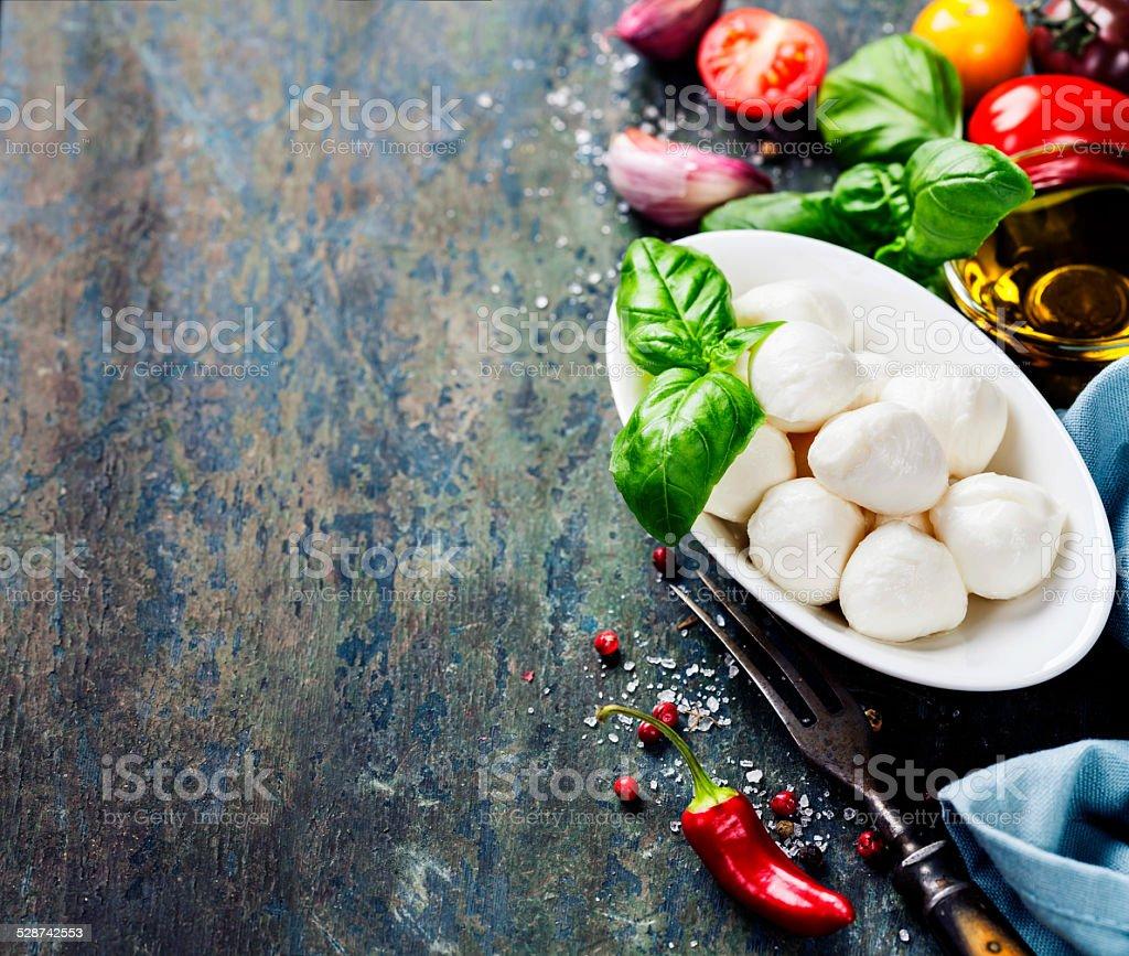 Mozzarella with tomatos and basil leaves stock photo