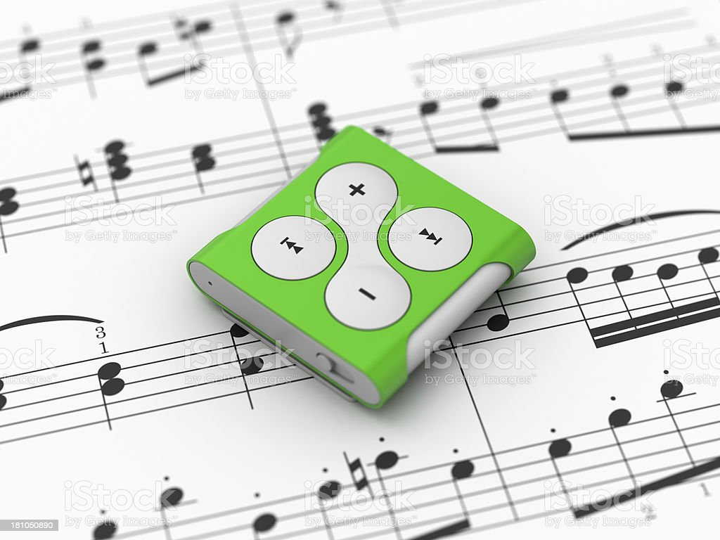 Mp3 player on notes background royalty-free stock photo
