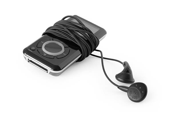 reproductor mp3 con auriculares - mp4 fotografías e imágenes de stock