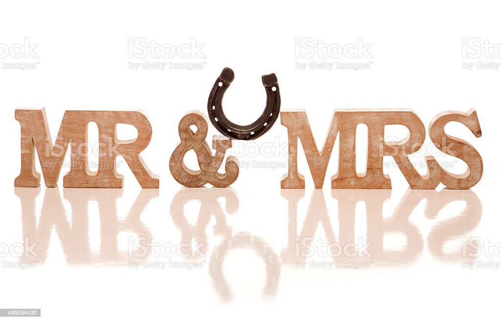 Mr and Mrs block sign with horse shoe stock photo