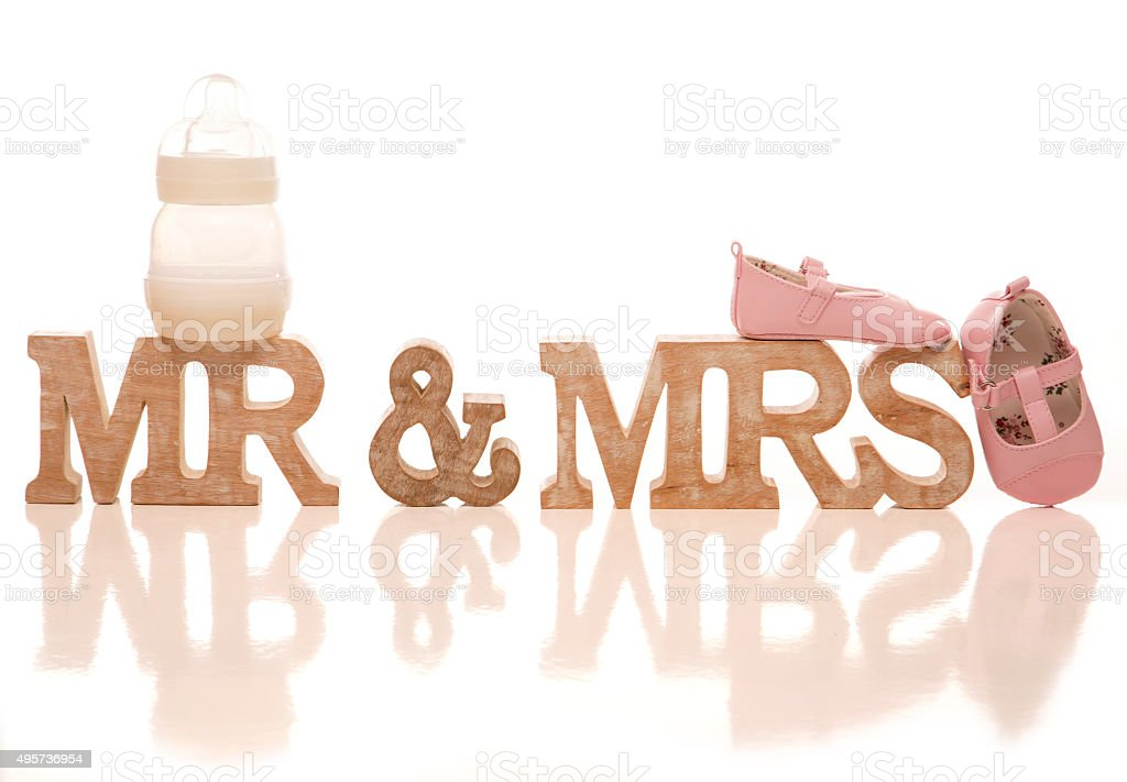 Mr and Mrs expecting a baby sign stock photo