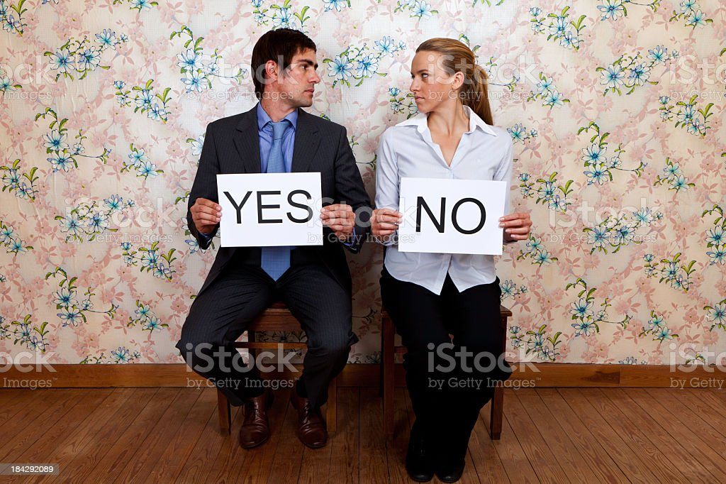 Mr Yes and Miss No Fighting stock photo