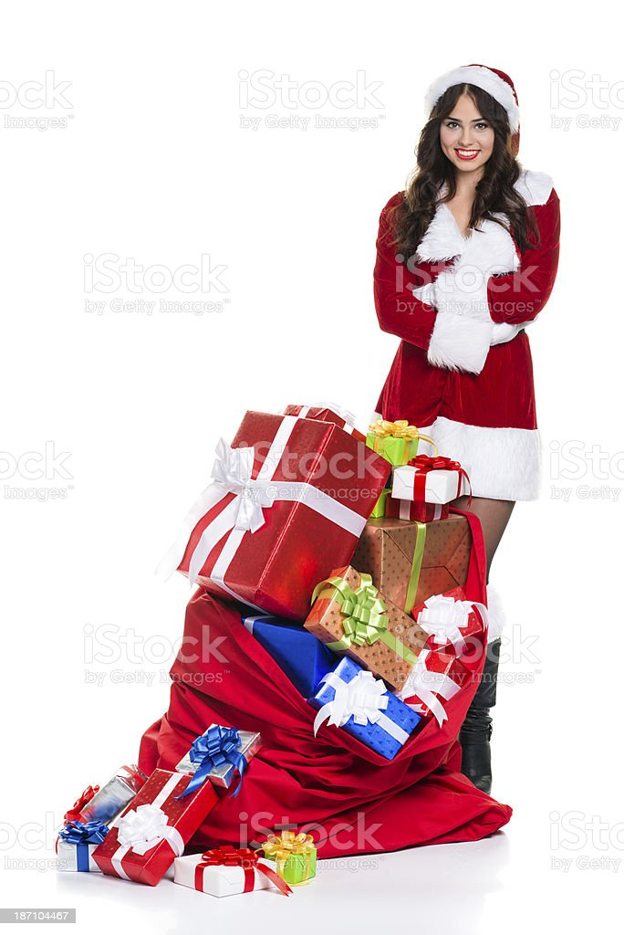 Mrs. Claus and bag full of gifts. stock photo