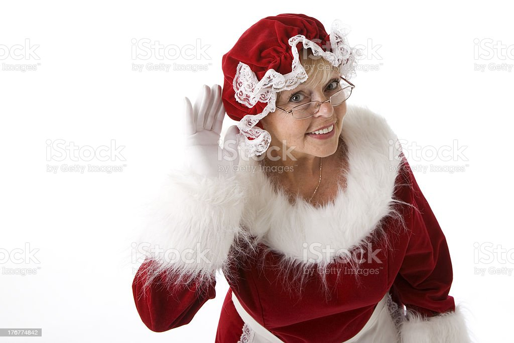 Mrs. Claus Listens Hand to her Ear royalty-free stock photo