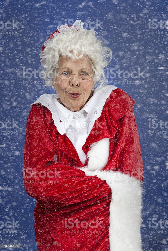 Mrs Claus outside in the snow stock photo