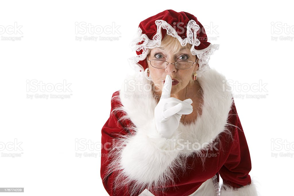Mrs. Claus Puts Finger to Lips Hush Be Quiet stock photo