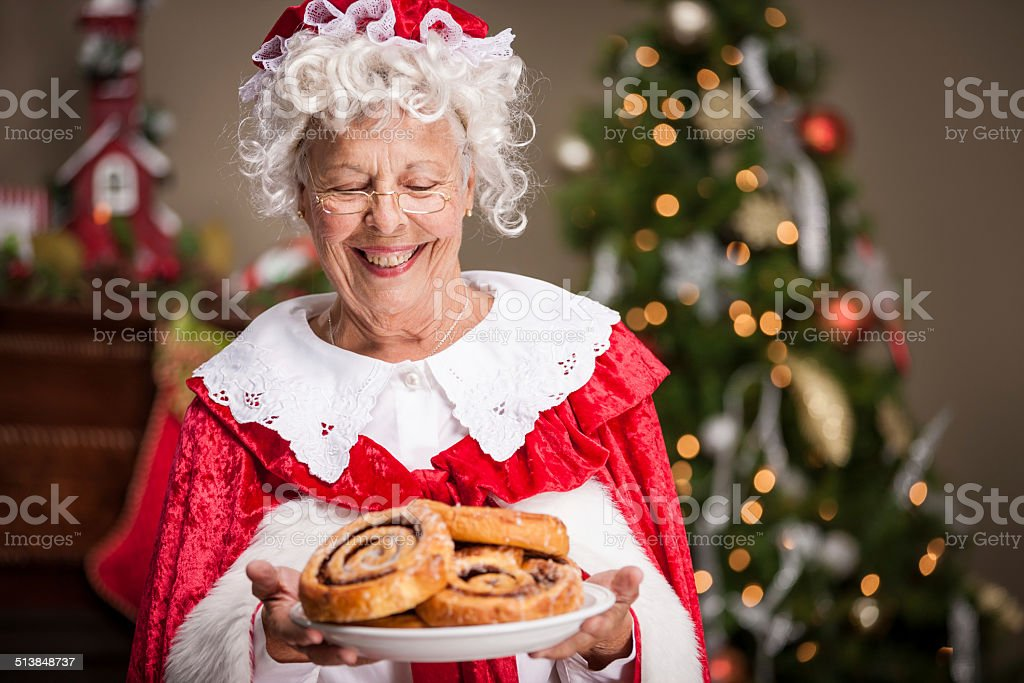 Mrs. Claus with Cinnamon Rolls stock photo