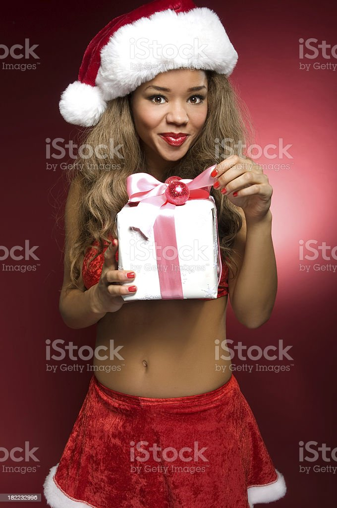 Mrs Santa Claus With A Gift royalty-free stock photo