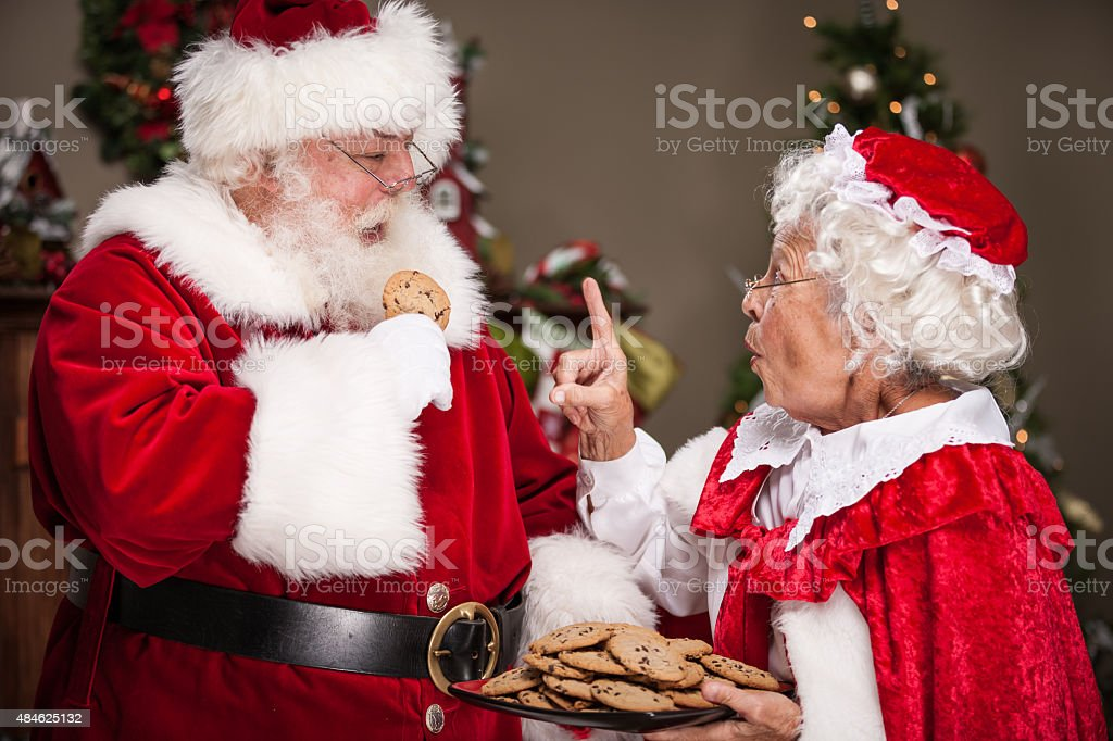 Ms claus scolds santa for eating too many cookies