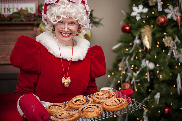 Ms. Claus With Cinnamon Rolls stock photo