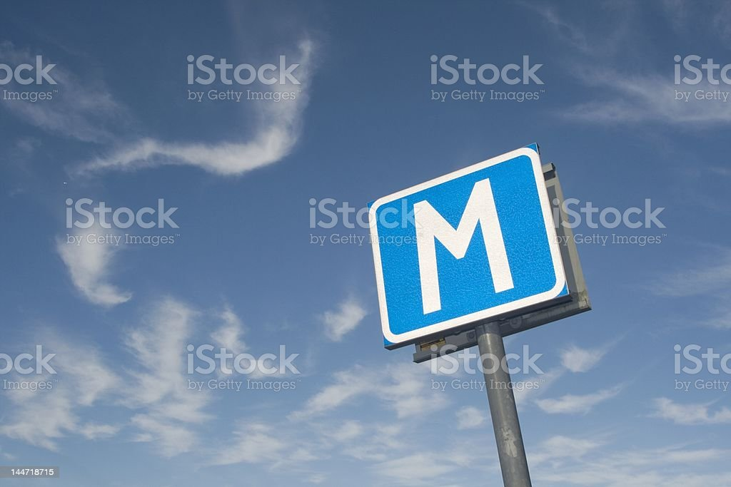 M-sign with blue sky royalty-free stock photo