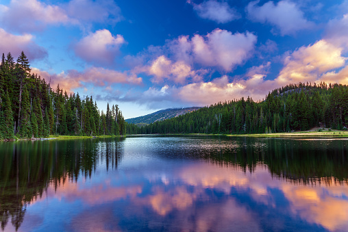 Mt. Bachelor during sunset, reflecting in the calm waters of Todd Lake. Bend, Oregon