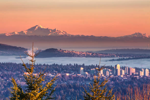 Mt Baker at foggy sunset Mt Baker at foggy sunset washington state stock pictures, royalty-free photos & images