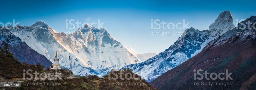 Mt Everest overlooking Buddhist stupa prayer flags Himalaya mountains Nepal stock photo