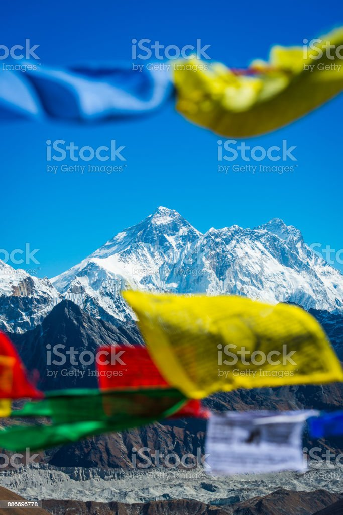 Mt Everest summit framed between Buddhist prayer flags Himalayas Nepal stock photo