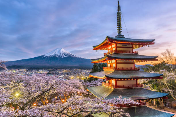 Mt. Fuji and Pagoda Mt. Fuji and temple pagoda in Fujiyoshida, Japan. pagoda stock pictures, royalty-free photos & images