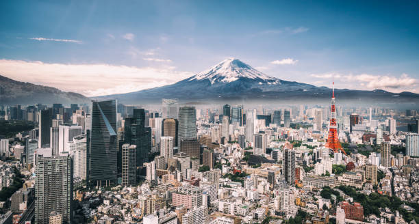 Mt. Fuji and Tokyo Skyline View of Mt. Fuji, Tokyo Tower and crowded buildings in downtown Tokyo. tokyo stock pictures, royalty-free photos & images