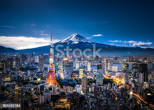 View of Mt. Fuji and Tokyo skyline at dusk.