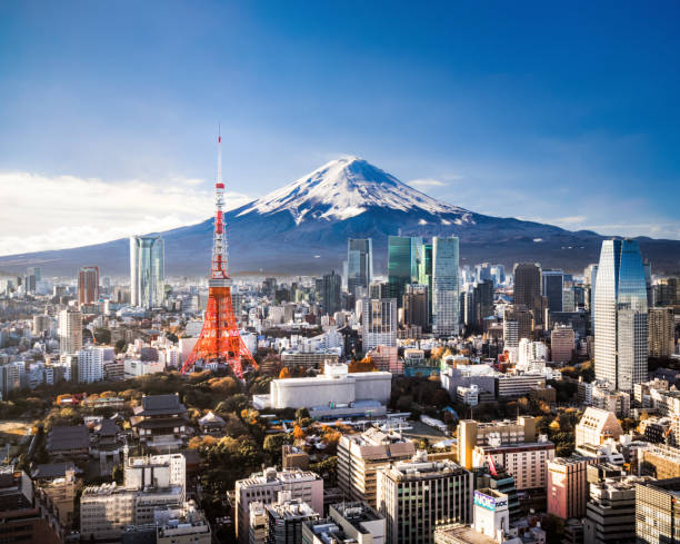 mt. fuji and tokyo skyline - tokyo japan stock photos and pictures