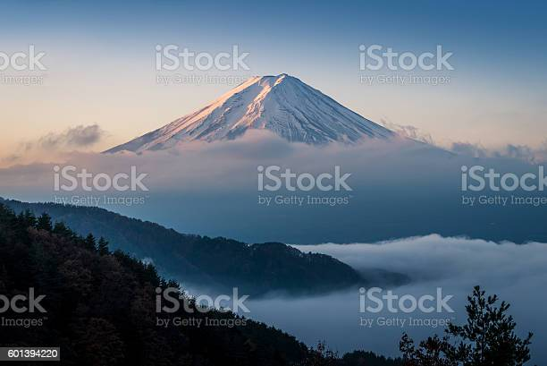 Photo of Mt. Fuji enshrouded in clouds with clear sky