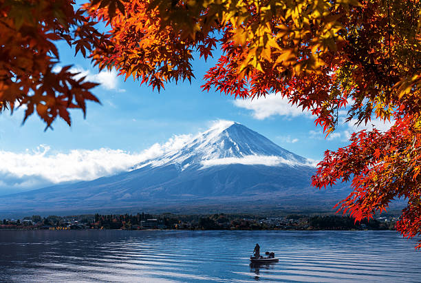 Mt Fuji in autumn view from lake Kawaguchiko Mt Fuji in autumn view from lake Kawaguchiko. Red maple leaves in Fuji. Autumn foliage around mount Fuji, Japan. View of morning sunrise of Fuji mountain. City around Fuji and lake Kawaguchiko. satoyama scenery stock pictures, royalty-free photos & images