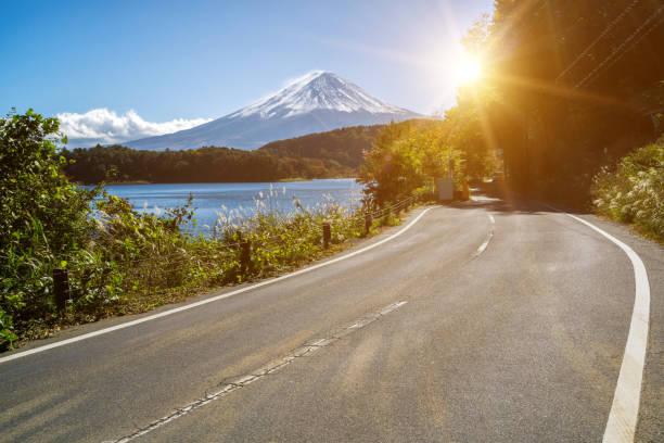 Mt Fuji in Japan and road at Lake Kawaguchiko Mt Fuji in Japan and highway road side of Lake Kawaguchiko. Road trip travel and tourism in Japan. lake kawaguchi stock pictures, royalty-free photos & images