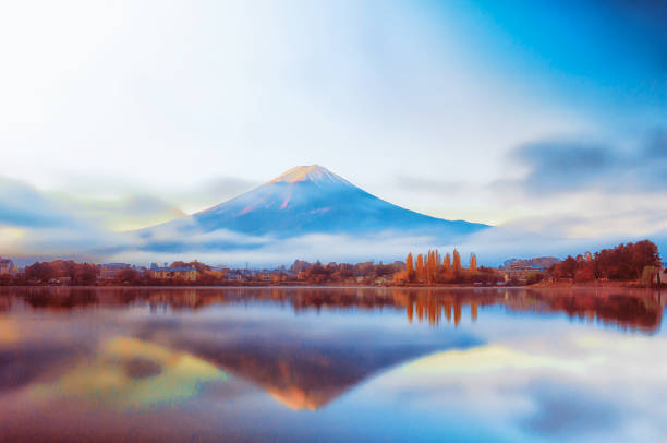 Mt Fuji in the early morning with reflection on the lake kawaguchiko stock photo