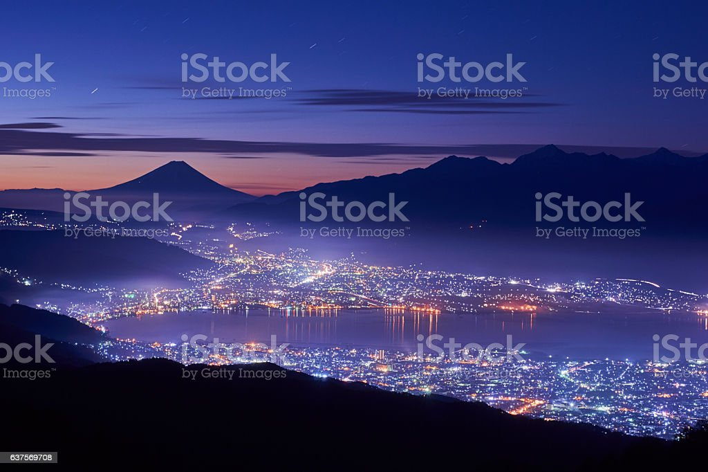Mt. Fuji over the lake Suwa stock photo