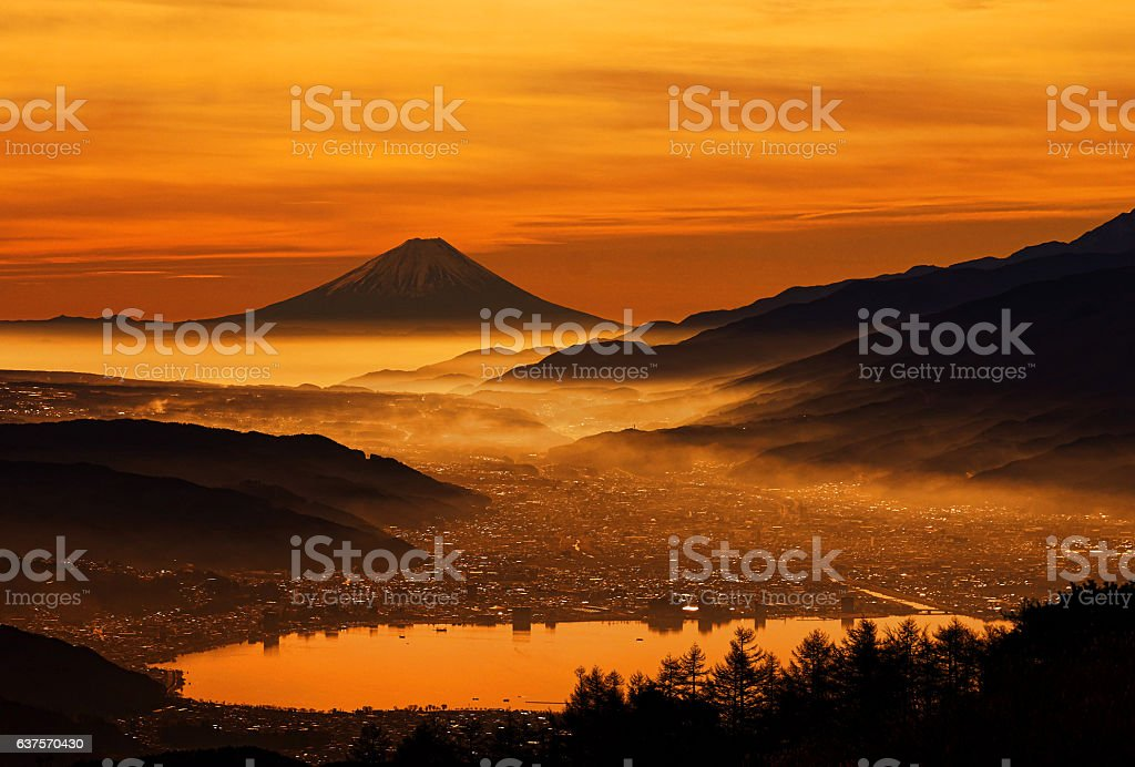Mt Fuji over the lake Suwa stock photo