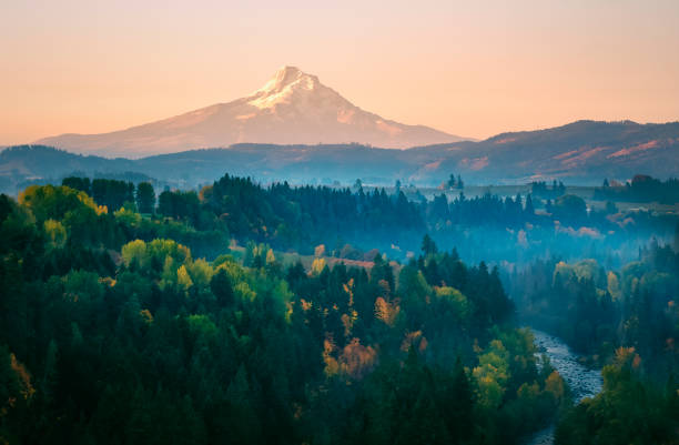 Mt Hood on a hazy autumn morning from the air above the Hood River stock photo