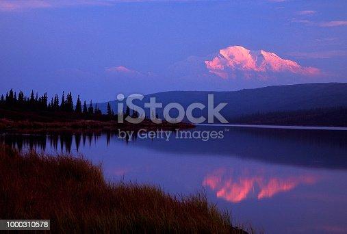 Mt. McKinley (Denali) Alpenglow reflected in Wonder Lake, Alaska.
