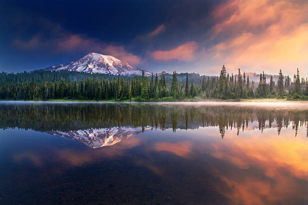 Mt Rainier and reflections This photo was taken in a foggy early morning. The lake was so calm that it's like a mirror. mt rainier stock pictures, royalty-free photos & images