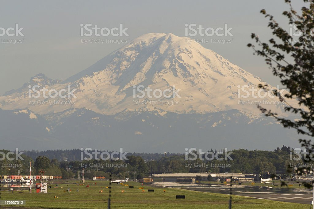 Mt. Rainier over King County International Airport (Boeing Field) royalty-free stock photo