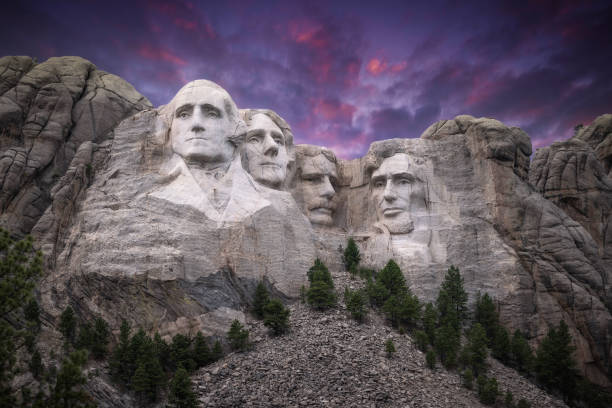 Mt. Rushmore Under a Stunning Sky Striking view of Mt. Rushmore framed by a colorful sky president stock pictures, royalty-free photos & images