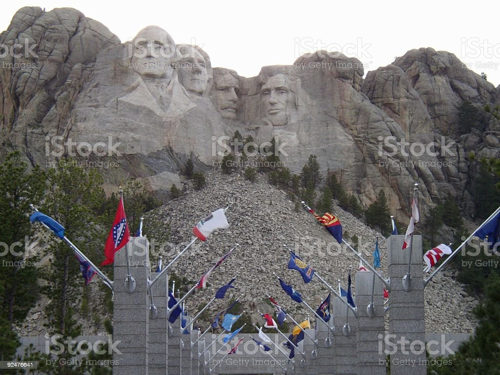 Mt Rushmore with flags royalty-free stock photo