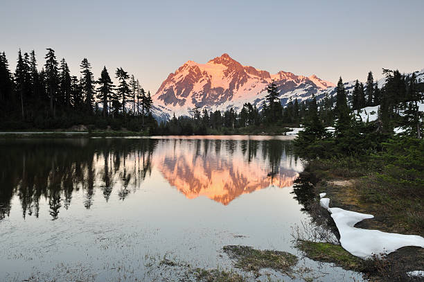 mt shuksan and picture lake at sunset stock photo