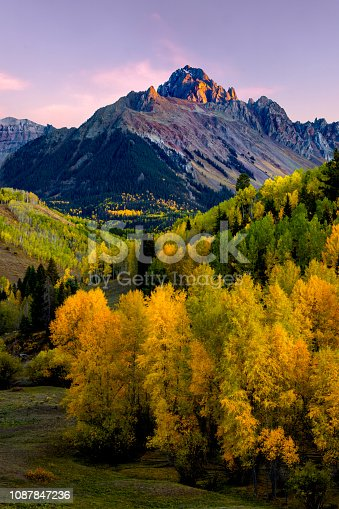 Sunset Alpine Glow on Mt Sneffels with Golden Aspen in the Valley