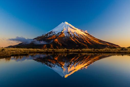 Stunning reflection of Mt Taranaki from the Pouakai tarns, South Island, New Zealand.