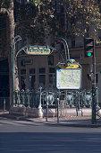 Paris, France - September 01 2016: Old-fashioned entrance of the Métro at Place de la Bastille with a map of the parisian subway.